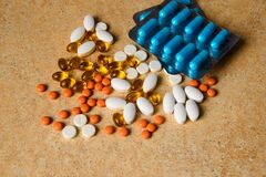 Free Blister With Blue, Pink And Orange Pills, Vitamin D And Fish Oil Capsules Royalty Free Stock Image - 177053096