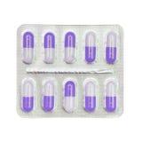 Blisterpackung violette und weiße Kapseln lokalisiert auf Weiß Stockbild