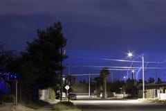 Blitz über Tucson, AZ-Nachbarschaft in der Nacht Stockfoto