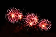 Blitze von Feuerwerken der rosa und weißen Farbe Stockbild