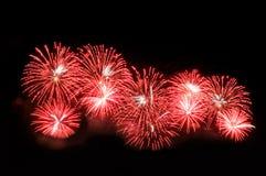 Blitze von Feuerwerken der roten und weißen Farbe Stockbild