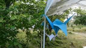 Origami crane in the wind. Bliue origami crane in the wind stock video footage