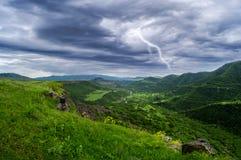 Blixtlandskap med stormmoln Royaltyfri Bild