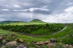 Blixtlandskap med stormmoln Royaltyfri Fotografi