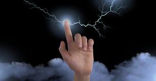 Blixtslag och finger som gristrar elektricitet fotografering för bildbyråer