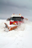 Blizzard. Snowplough clear snow in blizzard. Snow storm hit Denmark and truck struggle to scrape road stock images