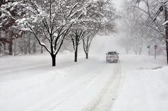 Blizzard 2010 Arlington VA. Lone car driving on snow covered street during the Blizzard of 2010 - Arlington VA Stock Photography