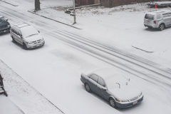 The blizzard of 2013, coined. Worcester, Massachusetts, USA - February 8: Cars parked on a Worcester city street at the beginning of the blizzard of 2013, also Stock Photos