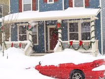 Blizzard. Christmas blizzard covers a red car Stock Images