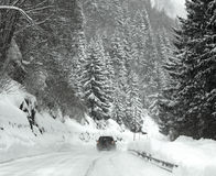 Blizzard on the Alps. It snows heavily on the Ploecken Pass route of the AuStrian Alps. Only few cars dare to cross the pass with the blizzard Royalty Free Stock Images