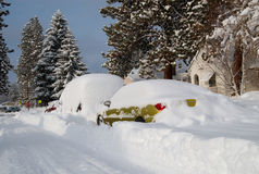 Blizzard Buried Cars. A winter storm buries cars parked along a street in two feet of snow Royalty Free Stock Images