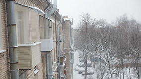 Blizzard in city. Snow blizzard. Winter weather with heavy snowfall stock video