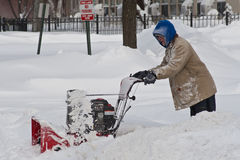 Blizzard Clean Up Chicago. Resident digging out of 2 feet of snow that fell in the Chicago region in the 3rd worst blizzard in recorded history. The storm left Royalty Free Stock Photo