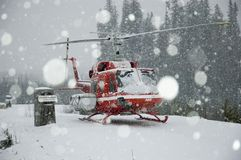 Blizzard, heli-skiing. A helicopter is grounded by a blizzard royalty free stock images