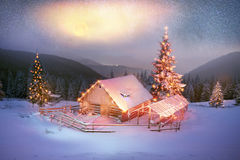 Blizzard lonely house. Ukraine, Carpathians strong snowstorm covered the mountains of sugar crust, like frosting. The gentle radiance glow of sunrise in a Stock Image