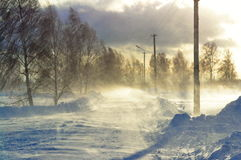 Blizzard on the road. The strong wind sweeps snow on the winter road Stock Photo