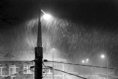 Blizzard, Straßenlaterne, Nacht Stockfotografie