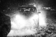 Blizzard in traffic black and white. Cars driving on the road in the aggravated traffic due to strong snowfall Stock Photography