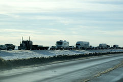 Blizzard Traffic Jam. Traffic pile-up caused by snow plows clearing highway after blizzard Stock Photos