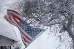 Blizzard. Wind blowing American Flag in winter Stock Photo