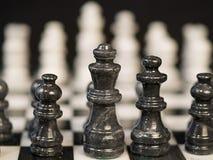 bllack κομμάτια σκακιού στοκ εικόνα