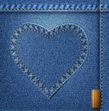Bllue jeanshjärta på denimbakgrund. Royaltyfria Foton
