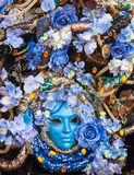 Bllue mask with floral decorations exhibited during the Carnival Stock Photography