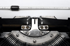 Blank paper in an old typewriter Royalty Free Stock Photo