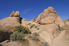 Bloßer und verwitterter Granit in der Wüste Stockbilder