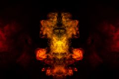 A blob of red and orange smoke in the form of a wavy pattern in the center of the frame depicting the head of a monster or an. Animal with eyes, not like a royalty free stock image