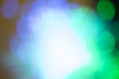 Blobs of light with white space in middle. Green blue white lights bokeh with white space in middle for text.Good for background image Royalty Free Stock Image