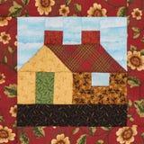Bloc de patchwork la maison de village dans le style rustique Images stock