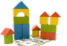 Bloc et argent de jouet Images stock