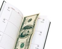 Bloc-notes avec de l'argent Photographie stock libre de droits