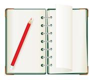 Bloc - notes avec le crayon rouge Photo stock