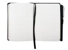 Bloc-notes avec le stylo d'isolement Photographie stock libre de droits