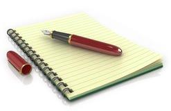 Bloc-notes avec le stylo-plume Photos libres de droits