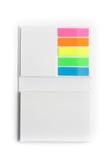 Bloc-notes avec les notes collantes colorées Photo stock