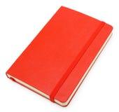 Bloc-notes de papier fermé rouge sur le blanc Image libre de droits