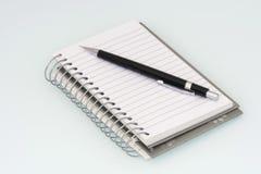 Bloc-notes et crayon Photos stock