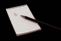 Bloc-notes et crayon Images stock