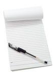 Bloc-notes et crayon lecteur Photographie stock libre de droits