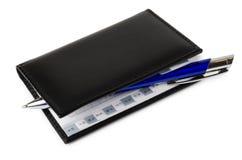 Bloc-notes et stylo à bille bleu Image stock
