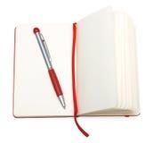 Bloc-notes ouvert de rouge (papier) avec le crayon lecteur et le signet Photo libre de droits
