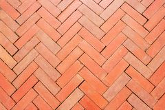 Bloc rouge extérieur de brique pavant sur un trottoir pour le decorati de conception photographie stock libre de droits