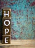 Blocchetti afflitti speranza di legno di parola Fotografia Stock