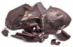 Blocchetti del cioccolato isolati su un bianco Fotografia Stock