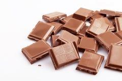 Blocchetti del cioccolato su bianco Immagini Stock Libere da Diritti