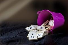 Blocchetti della lettera in un secchio Fotografia Stock