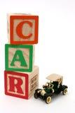 Blocchetti di ABC ed automobile antica nera Fotografia Stock Libera da Diritti